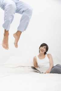 a man jumping on a mattress