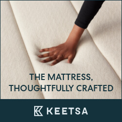 a hand on a Keetsa mattress