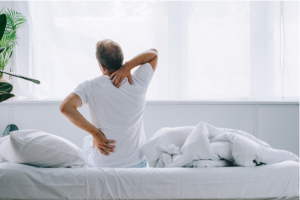 a man in bed with back pain
