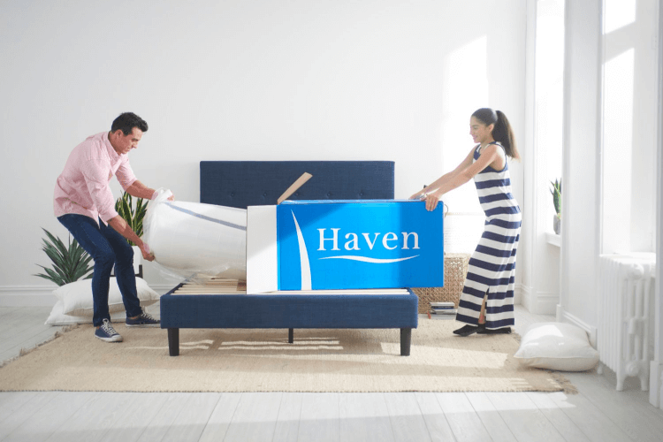 a couple unboxing a Haven mattress